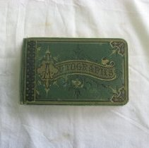 "Image of 2009.931.1 - Autograph album with green,black, and yellow cover entitled ""Autographs.""  Pages are edged in gold leaf. First entry reads ""Pauline A. Veo Hudson, Mass 1882."""