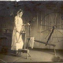 Image of 1977.083.0048 - Mrs. Merlin rubbing yarn.