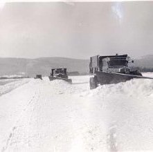Image of 1977.103.0011g - Plowing snow at Floyd Bennet Field; winter 1942.
