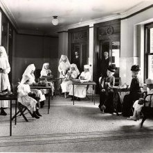 Image of 1978.003.1132 - A group of people knitting at the Red Cross.