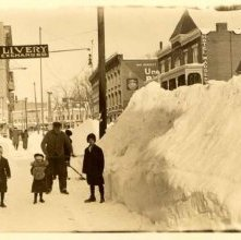 Image of 1978.003.1324 - South Street, 1914. Aftermath of a snowstorm. Shows people by a snowbank.