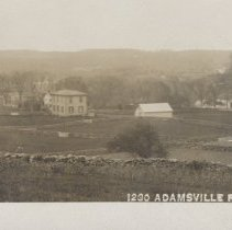 Image of 2005.081.449 - Postcard of  Adamsville, R. I.  showing farmland and large homes, stone walls and fields.