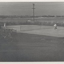 """Image of 2005.089.046 - Tennis court near ocean - probably part of the beach house on the Charlton Estate.  Written on back """"Below light house""""."""