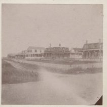 """Image of 2006.040.027 - About 1898 View of Summer homes, Acoaxet Right to left Jane F. Hawes Leander Lovell (formerly Mrs. Fidelia Durfee) Oliver S. Hawes """"The Ancorage) Chas. C. Buffinton Jos. F. Jackson Dr. D. H. Babcock Earle P. Charlton (next to old Parrlion) The two Hawes cottages were moved to lots West of Pavilion in 1899 and replaced (in 1900) by two large cottages of which Mrs. Wm. P. Rogers remains after extensive post hurricane repairs in 1938, 1944 and 1954.  Dr. Babcock's house also survived all three hurricanes, Jackson's was moved to Hurricane Lane in 1939."""