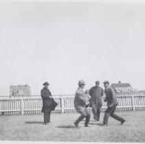 Image of 2006.040.053 - Before 1938 Hurricane, Acoaxet Men Roughhousing in yard