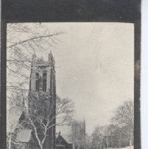 Image of 2006.042.109 - Left view of a tall, four-squared church tower, bare tress and a road in the foreground.