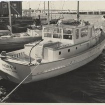 Image of 2006.042.175 - Photograph of the boat NORA-H of Dartmouth, MA at a slip in Westport Point.  Point bridge in the background.