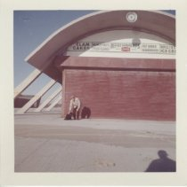 Image of 2006.042.280 - Colored photo of Horseneck Beach concession stand in November 1960, showing man with pet dog.