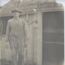 Image of 2008.019.001 - Johnnie Barton outside of shed at Cozy Cottage, Horseneck Road (Next to 103) Westport, Mass.