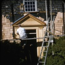 Image of 2015.012.146 - Working on new front door at Handy House.