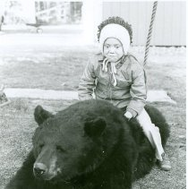 Image of CHILD ON A BEAR - CHILD ON A BEAR
