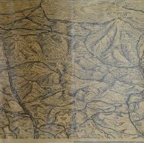 """Image of """"3 D"""" view of White Mountains.  Appears to be from a newspaper or brochure.  Shows roads, lakes, mountains.  Author: Brusseau.  2 copies; copies 2 & 3 are photocopies."""
