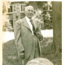 Image of George Vallentyne beside the Red Rock at Medicine Lake - 6M Red Rock Camp Meeting