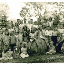 Image of Red Rock campmeeting 1943, children gathered around Red Rock - 6M Red Rock Camp Meeting