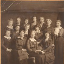 Image of Women's Foreign Missionary Society, Minneapolis Branch members, Mrs. Lindsey holding booklet - 6B Women's Foreign Missionary Society
