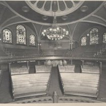 """Image of Minneapolis, Wesley UMC, interior, captions says, """"The Wesley Sanctuary was originally illuminated by a large central chanderier."""" - L-Minneapolis, Wesley UMC"""