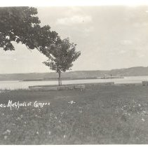 Image of Frontenac Methodist Campus-grassy field looking at barge on lake