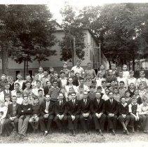 Image of Group of men and boys, seated - 6F Lake Koronis
