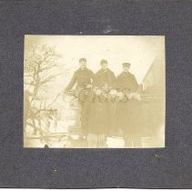 Image of Five Men Posed on a Wagon - Winter - 2014.14.4