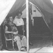 Image of Young Couple in a Furnished Tent