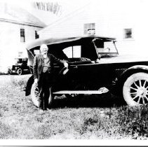 Image of Man Standing Beside An Automobile - 2001.1.8