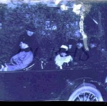 Image of Five Adults and a Child in an Early Automobile - E.W. Moore Group - 2011.23.19
