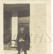 Image of Roy F. Baker Seated on Porch  - 2011.24.14