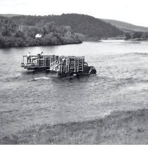 Image of Men Unloading Pulp from Trucks in the Kennebec River, Bingham - 2011.7.1