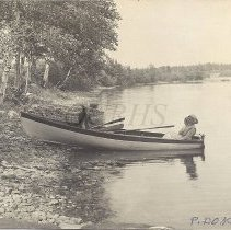 Image of Boat Beached on the Shore of Pleasant Pond 1911 - 2012.13.86