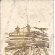 Image of Two Men on Logs at the Shank Mill, Bingham ME - 2015.22.27