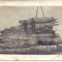 Image of Two Men with Cant Dogs on a Log Pile - 2015.22.29