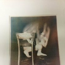 Image of Print - The image is a four plate color lithograph (yellow, magenta, cyan and black) printed on a Charles Brand lithography press.  The original photo was taken with a 35 mm camera and a very long exposure as the model moved around the chair which remained still.  From a single initial  35 mm negative, the artist made four large positives on the ortho film of different densitities, each intended for the four color plates that the lithograph was made from.   The model was a friend of the artist as she progressed through her pregnancy.  This print was a part of series as the friend progressed through her pregnancy until the baby was born.