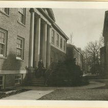 Image of Man leaving with two children - Black & white image of the exterior of Wadsworth Hall showing man and two young children walking down the steps.