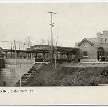 Image of The Station lake Bluff, Ill - Black & while postcard of depot looking north from bridge.