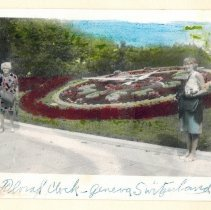 Image of A Christmas card from the Beall sisters, showing Cornelia and Yolande in front of a floral clock in Geneva, Switzerland.