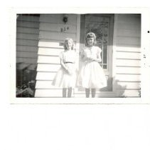 Image of Lake Bluff Childrens Home Executive Director Robert Beers daughters, Kathy left and Susan right at entry to directors house, located at 224 Center.