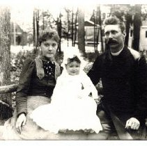 """Image of L to R  Lillian Honeywell Beall, Homer Honeywell Beall and Rev. Thomas Allen Beall """"Looking toward Parkhurst (later Fred Young) home on corner of Sunrise and Ravine.  Photo taken near Park Place and Ravine."""""""