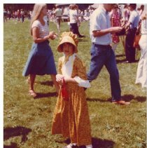 Image of Girl posing at the Bicentennial - A girl in a dress poses for a picture at the Bicentennial Celebration