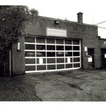 Image of Fire station and public works     - Seventy-four black and white photographs of the fire station and public works taken in 1982. Many interior photos of the offices, storage, boiler and mechanical rooms; fire trucks, hoses, and Village Hall without the tower with a police car in the driveway. Some duplicates.