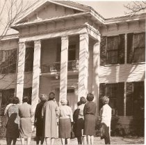 Image of Club women stand outside the home they hope to save from demolition