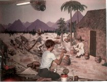 Image of Clubwoman paints a mural