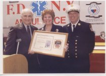 Image of GFWC International President Judy Lutz with FDNY Chief of Dept. Frank Cruth