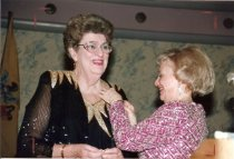 Image of Ann L. Holland, receiving pin from Phyllis J. Dudenhoffer