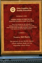 Image of harris issues ultimatum on charter schools and vouchers - Plaque