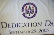 Image of Banner-white background color with purple lettering.  Dedication day September 29, 2006.   - Banner