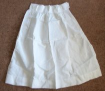 Image of White cotton apron bottom.  Has two detachable pearl buttons on the waist band. Has name M. Watts written on the waist band.   - nurses uniform dress