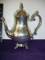 Image of Table service ware silver pitcher with attached lid. - Pitcher