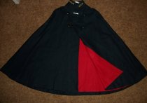 "Image of 2 items, 1-navy blue wool cape with embroidered intials M. G. H. with red flannel linning, 2-mother of pearl pin 2"" x 1/4"" with the name Miss Hall. - nurses uniform dress"