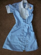 Image of Uniform unknown date.  Light blue shirt waist cotton dress with white collar, cuffs and pin-tucked yoke. - nurses uniform dress