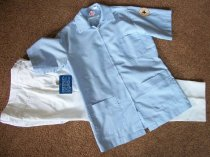 Image of Uniform Unkown.  Male nurse light blue cotton/polyester tunic short sleeve has round patch Mansfield General Hospital on the left sleeve.  - nurses uniform dress